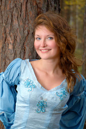 Very beautiful girl in medieval dress in autumn wood Stock Photo - 7856791