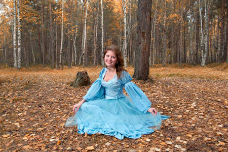 Very beautiful girl in medieval dress in autumn wood Stock Photo - 7856790