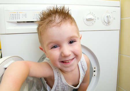 caucasian  small boy from washer  photo