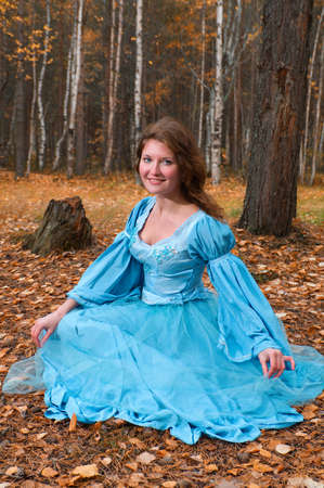 Very beautiful girl in medieval dress in autumn wood Stock Photo - 7955524