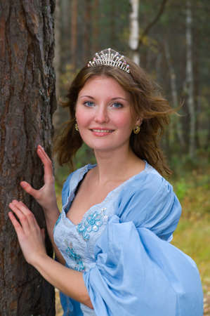 Very beautiful girl in medieval dress in autumn wood.crown  Stock Photo - 7955531