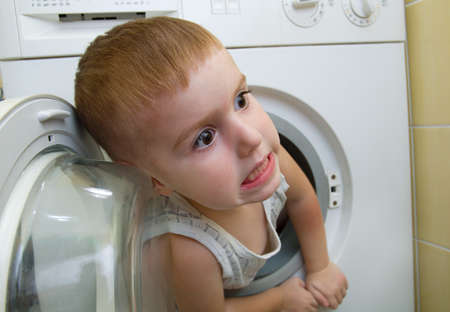 caucasian  small boy from washer  Stock Photo - 7955528