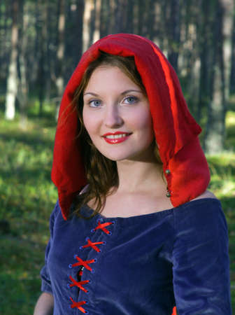 red Riding  hood standing in a wood . beautiful girl in medieval dress Stock Photo - 7955541