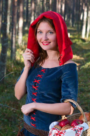 red Riding  hood standing in a wood . beautiful girl in medieval dress Stock Photo - 7955537