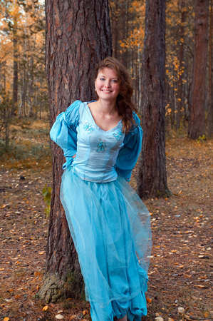 Very beautiful girl in medieval dress in autumn wood Stock Photo - 8074050