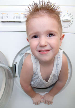 caucasian  small boy from washer  Stock Photo - 8074056