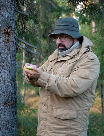taiga: Hiker  in forest .boondocks -taiga .studies compass