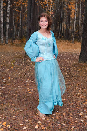 Very beautiful girl in medieval dress in autumn wood Stock Photo - 8144391