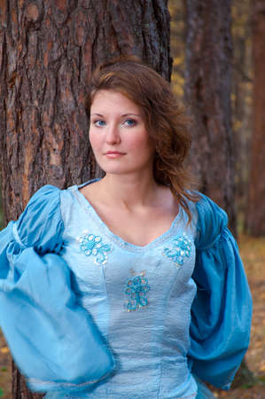 Very beautiful girl in medieval dress in autumn wood Stock Photo - 8144382