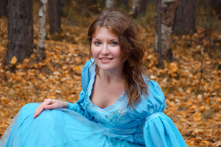 Very beautiful girl in medieval dress in autumn wood Stock Photo - 8144393