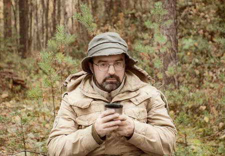 forest tea: Hiker drink hot tea on halt in forest .boondocks -taiga