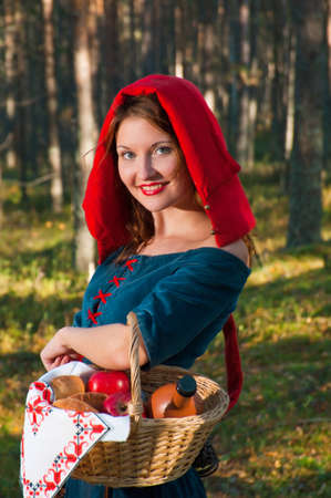 red Riding  hood standing in a wood . beautiful girl in medieval dress Stock Photo - 8166777