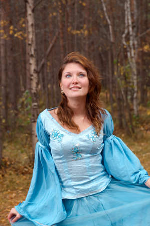 Very beautiful girl in medieval dress in autumn wood Stock Photo - 8167130