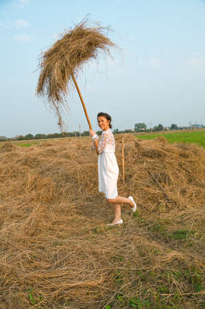 country romantic bride on haystack. photo