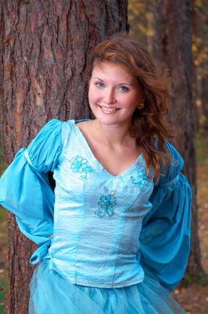 Very beautiful girl in medieval dress in autumn wood Stock Photo - 8232223