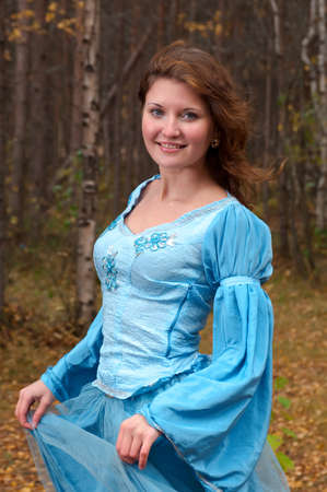 Very beautiful girl in medieval dress in autumn wood Stock Photo - 8232331