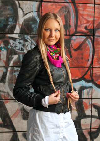 beauty young blonde woman posing in front of colorful grafitti  photo