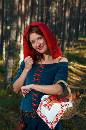 red Riding  hood standing in a wood . beautiful girl in medieval dress Stock Photo - 8303565