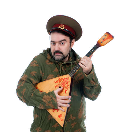 Russian soldier with balalaika isolated on white background  photo