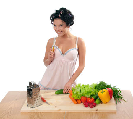Housewife with vegetables .Studio, white background. Stock Photo - 9073894
