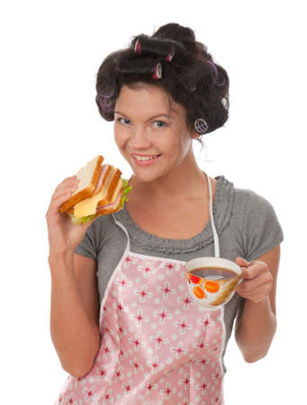 Beautiful cooking woman in apron with sandwich.Studio, white background.  photo