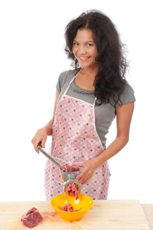 Meat Grinders  .beautiful housewife cutting meat. .Studio, white background.  photo