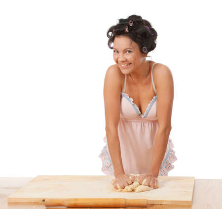 housewife mix dough on the wooden board.Studio, white background.  photo