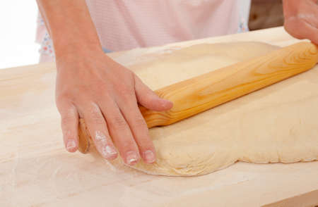 mix dough on the wooden board . Studio, white background.  photo