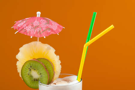 Milkshake with chocolate and fruit on yellow background  photo