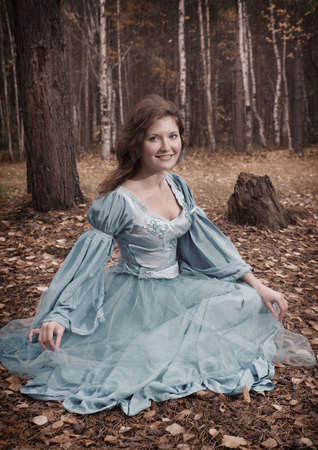 Very beautiful girl in medieval dress in autumn wood Stock Photo - 9593166