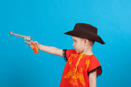little boy wearing a cowboy hat a over blue background photo