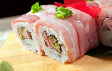Japanese sushi  traditional japanese food.Roll made of bacon Stock Photo - 9580542