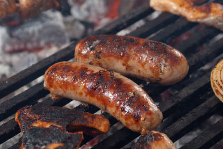 Sausages  on the Barbecue Grill.Shallow depth-of-field. photo