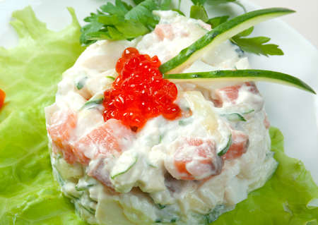 Healthy vegetarian Salad with salmon and roe on the white plate over white Stock Photo - 9852405