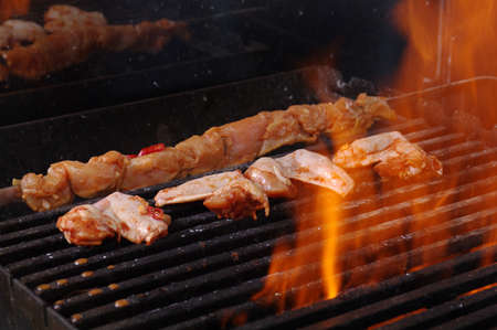 cooking chicken barbecue  Shallow depth-of-field. Stock Photo - 9852638