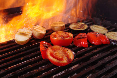 oven potatoes: cooking vegetables  barbecue .closeup Stock Photo