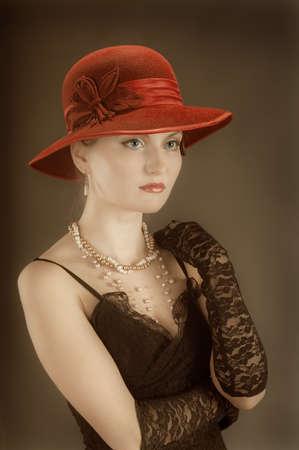 Woman retro revival portrait.girl in hat photo