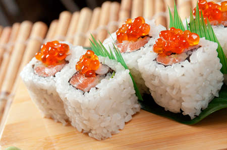 Japanese sushi  traditional japanese food.Roll made of Smoked fish and red roe photo