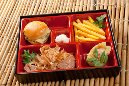 Japanese Bento Lunch .box of fast food with with pork,sandwich and vegetable photo