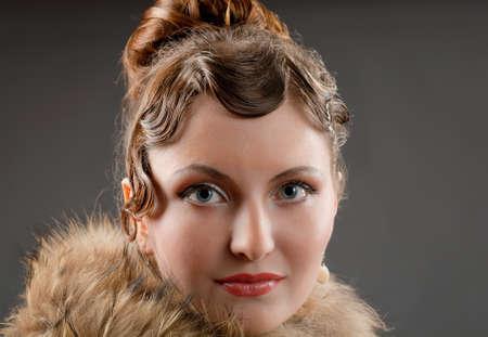 Woman retro revival portrait.girl in boa photo