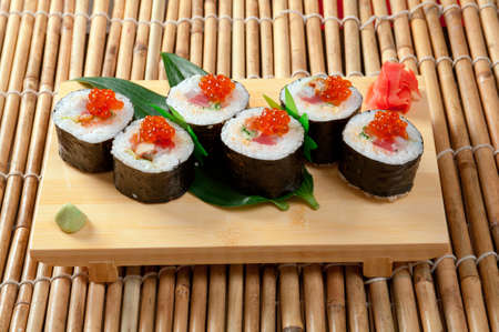 roe: Japanese sushi  traditional japanese food.Roll made of Smoked fish and red roe Stock Photo