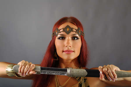 young warrior woman holding sword in her hand Stock Photo - 10193189
