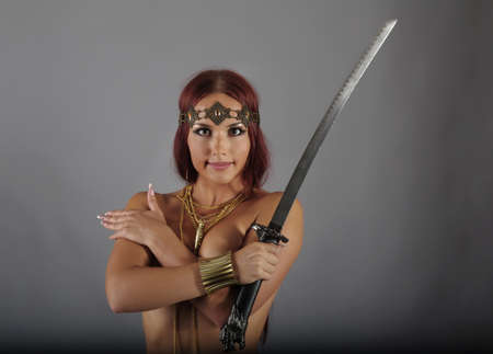 young warrior woman holding sword in her hand Stock Photo - 10224111