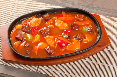 chinese cuisine .pork with tart sweet sauce,pineapple and pepper photo
