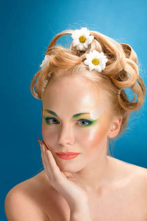 Portrait of beautiful girl  blonde with flowers in her hair  photo