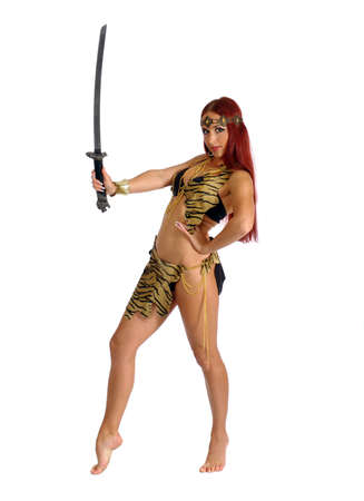warrior girl: young warrior woman holding sword in her hand isolated on white background