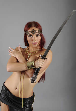 young warrior woman holding sword in her hand Stock Photo - 10549829