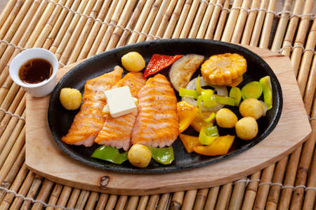 seafood dinner: Japanese cuisine .Salmon Steak with Vegetable