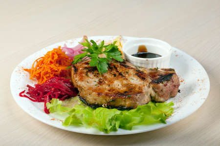 grilled t-bone pork steak and vegetables 写真素材