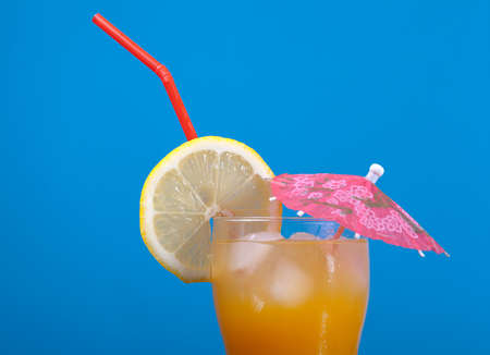tropical cold cocktail  closeup on blue background. Stock Photo
